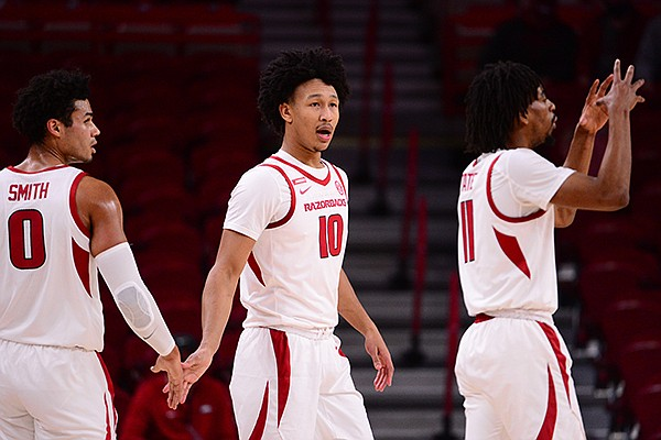 Arkansas players Justin Smith (0), Jaylin Williams (10) and Jalen Tate (11) are shown during a game against Mississippi Valley State on Wednesday, Nov. 25, 2020, in Fayetteville.