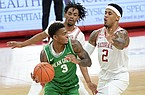 North Texas' Javion Hamlet (3) is double teamed by Arkansas' Vance Jackson (2) and Jalen Tate during a game Saturday, Nov. 28, 2020, in Fayetteville.