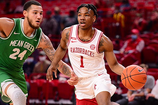 Arkansas' JD Notae (1) drives around North Texas' Zachary Simmons (24) during a game Saturday, Nov. 28, 2020, in Fayetteville.