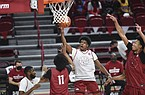 Arkansas guard Khalen Robinson (12) shoots, Thursday, November 11, 2020 during the Red-White instrasquad basketball game at Walton Arena in Fayetteville. Check out nwaonline.com/201113Daily/ for today's photo gallery.  (NWA Democrat-Gazette/Charlie Kaijo)