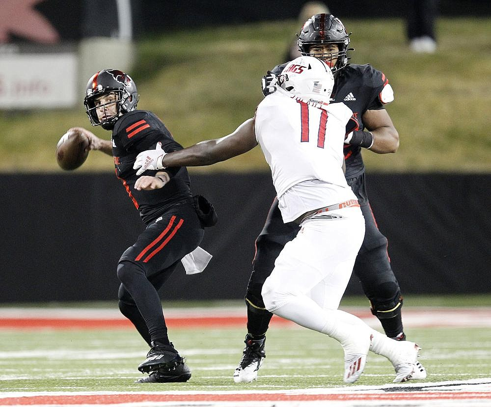 Arkansas State quarterback Layne Hatcher tries to get off a pass while being pressured by South Alabama's Jamie Sheriff during the Red Wolves' loss to the Jaguars on Saturday in Jonesboro. More photos available at arkansasonline.com/1129asusa. (Arkansas Democrat-Gazette/Thomas Metthe)