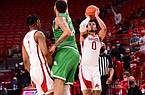 Arkansas forward Justin Smith attempts a 3-pointer during a game against North Texas on Nov. 28, 2020, in Bud Walton Arena in Fayetteville.