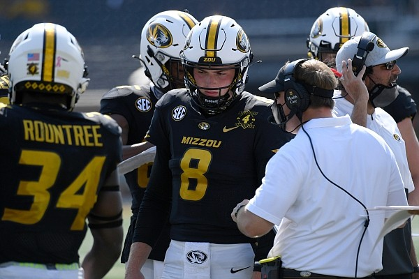 Missouri head coach Eliah Drinkwitz talks with quarterback Connor Bazelak (8) during the second half of an NCAA college football game against LSU Saturday, Oct. 10, 2020, in Columbia, Mo. (AP Photo/L.G. Patterson)