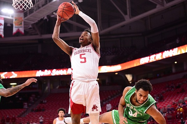 Arkansas guard Moses Moody attempts a layup after drawing contact during a game against North Texas on Nov. 28, 2020, in Bud Walton Arena in Fayetteville.