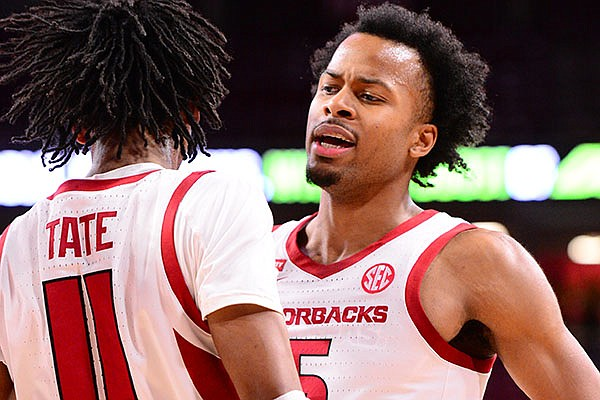 Arkansas' Moses Moody (5) celebrates with teammate Jalen Tate (11) during a game against Texas-Arlington on Wednesday, Dec. 2, 2020, in Fayetteville.