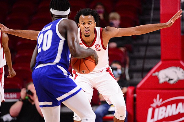 Arkansas' Moses Moody (5) guards Texas-Arlington's Nicolas Elame (20) during a game Wednesday, Dec. 2, 2020, in Fayetteville.