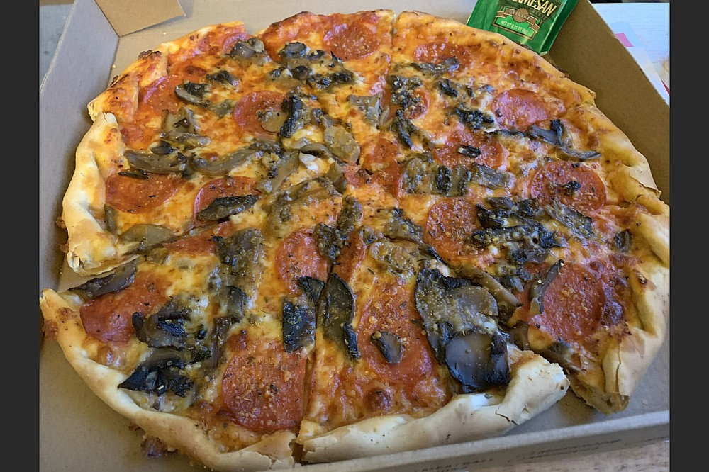 A 13-inch pepperoni and mushroom pie from Pizza Cafe West wasn't hot when we got it home, but it was delicious. (Arkansas Democrat-Gazette/Eric E. Harrison)