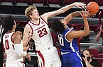 Arkansas' Connor Vanover (23) blocks a shot attempt by Texas-Arlington's Fredelin De La Cruz (10) during a game Wednesday, Dec. 2, 2020, in Fayetteville.