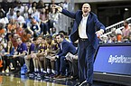 Lipscomb head coach Lennie Acuff talks to the team from the sidelines during the first half of an NCAA college basketball game against Auburn Sunday, Dec. 29, 2019, in Auburn, Ala. (AP Photo/Julie Bennett)