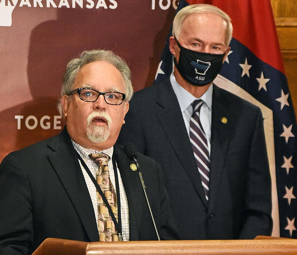 Health Secretary Jose Romero (left), at Thursday's briefing with Gov. Asa Hutchison, said officials are considering limiting the size of indoor gatherings and requiring events with more than 10 people to submit plans to the Health Department. (Arkansas Democrat-Gazette/Staci Vandagriff)