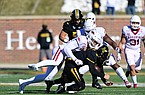 Arkansas defensive end Julius Coates sacks Missouri quarterback Connor Bazelak during a game Saturday, Dec. 5, 2020, in Columbia, Mo.