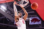 Arkansas forward Justin Smith (0) dunks the ball during a game against Southern on Wednesday, Dec. 9, 2020, in Fayetteville.