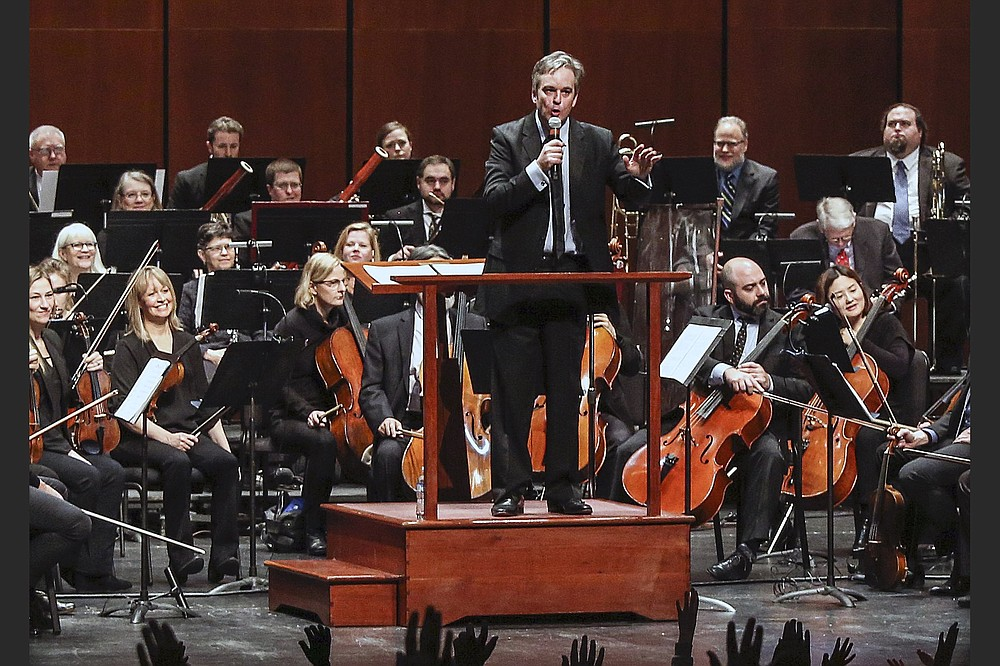 """Geoffrey Robson conducts the orchestra in a not-quite-impromptu """"Home for the Holidays"""" concert, streaming Sunday afternoon from Little Rock's Robinson Center Performance Hall. (Democrat-Gazette file photo)"""