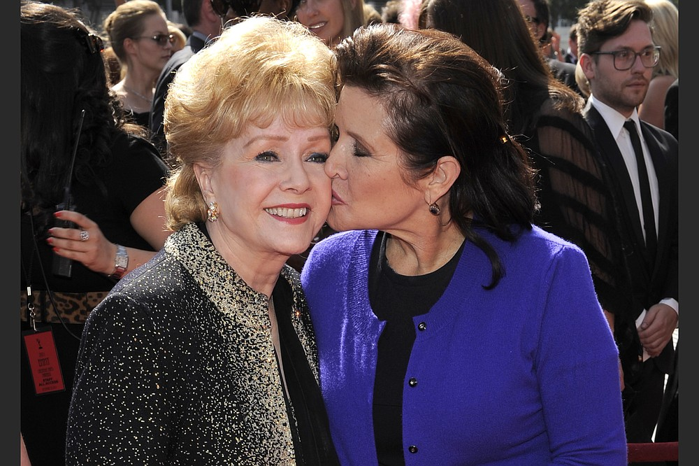 Debbie Fisher (left) and Carrie Fisher, were photographed in 2011. (AP)