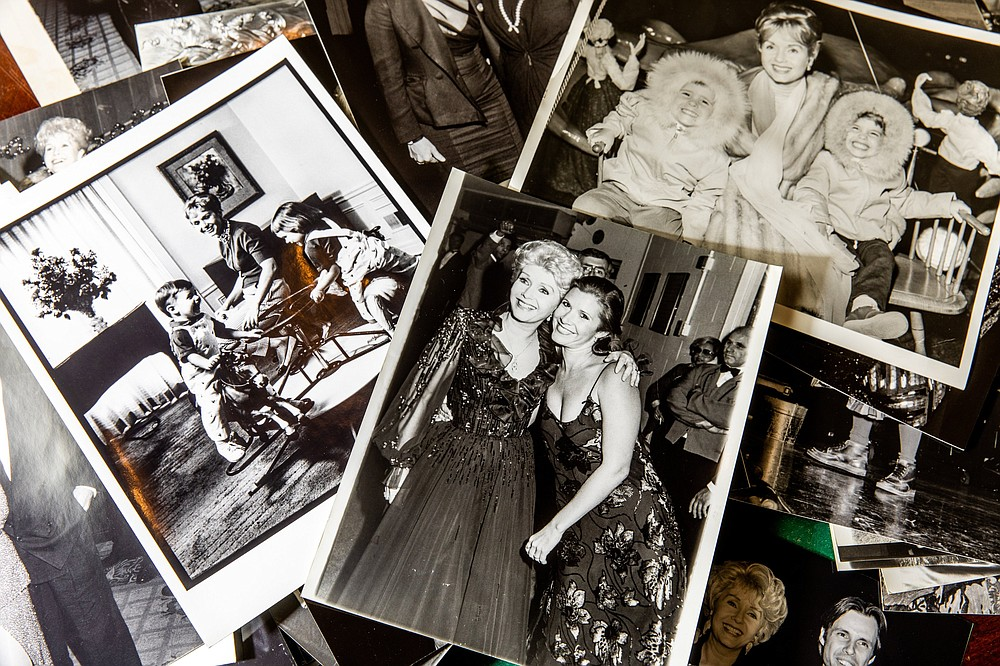 Photos of Debbie Reynolds and her children, Carrie Fisher and Todd Fisher, are part of the late actress's collection. (The New York Times/Roger Kisby)