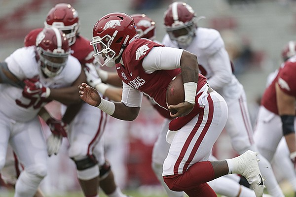 Arkansas quarterback KJ Jefferson runs with the ball during a game against Alabama on Saturday, Dec. 12, 2020, in Fayetteville.
