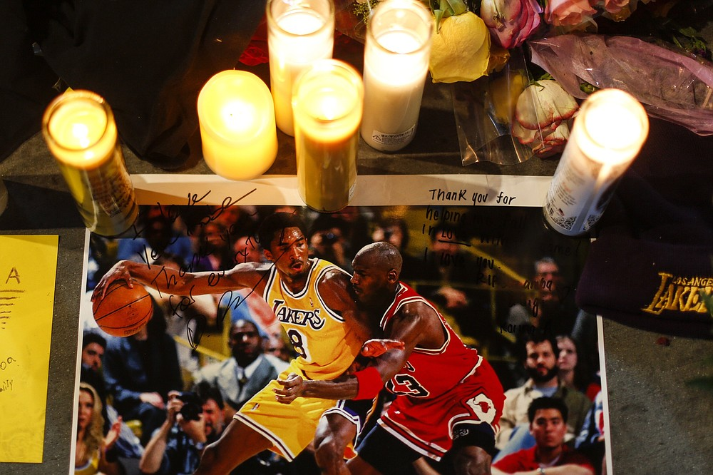 A picture of Kobe Bryant and Michael Jordan is shown at a memorial for Bryant in front of Staples Center on Jan. 28 in Los Angeles. Bryant, the 18-time NBA All-Star who won five championships and became one of the greatest basketball players of his generation during a 20-year career with the Los Angeles Lakers, died in a helicopter crash on Jan. 26. (Ringo H.W. Chiu/AP file)