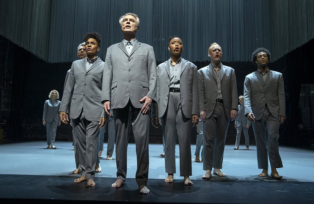 """David Byrne (foreground) is shown in a scene from """"David Byrne's American Utopia."""" The filmed version of the Broadway concert helmed by Spike Lee finds the sweet spot in translating the exhilaration of live performance to the screen. (HBO via AP)"""