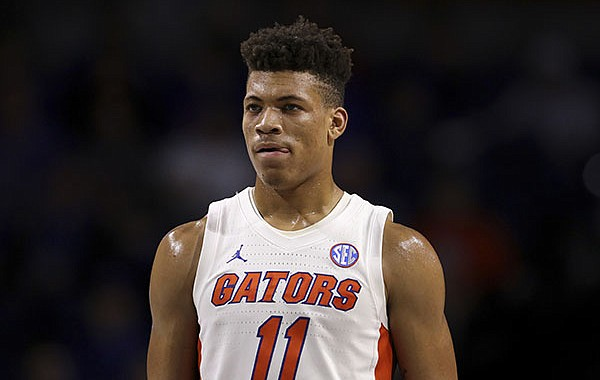 In this Nov. 29, 2019, file photo, Florida forward Keyontae Johnson (11) looks on during during the first half of an NCAA college basketball game against Marshall in Gainesville, Fla. Johnson, the Southeastern Conference's preseason player of the year, collapsed coming out of a timeout against rival Florida State and needed emergency medical attention Saturday, Dec. 12, 2020. He was taken off the floor on a stretcher and rushed to Tallahassee Memorial for evaluation. (AP Photo/Matt Stamey, File)
