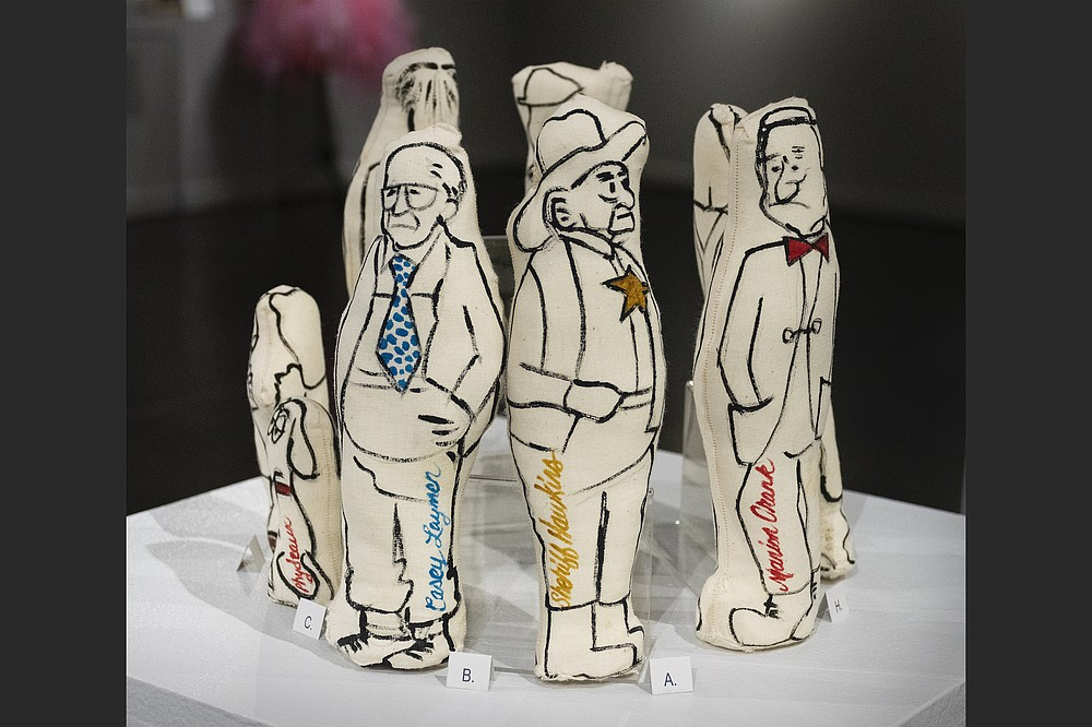 """Eight cloth dolls of Arkansas political figures made by Rosemary Fisher for """"Phydeaux and His Friends,"""" the 1950s political satire show she created with her husband, cartoonist George Fisher, are on display at the Arts & Science Center for Southeast Arkansas in Pine Bluff. (Special to the Democrat-Gazette)"""