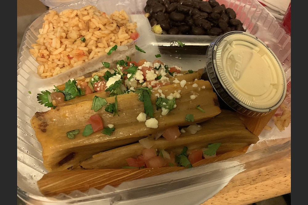 Three small beef tenderloin tamales from The Fold: Botanas & Bar in Riverdale came with rice and black beans. (Arkansas Democrat-Gazette/Eric E. Harrison)