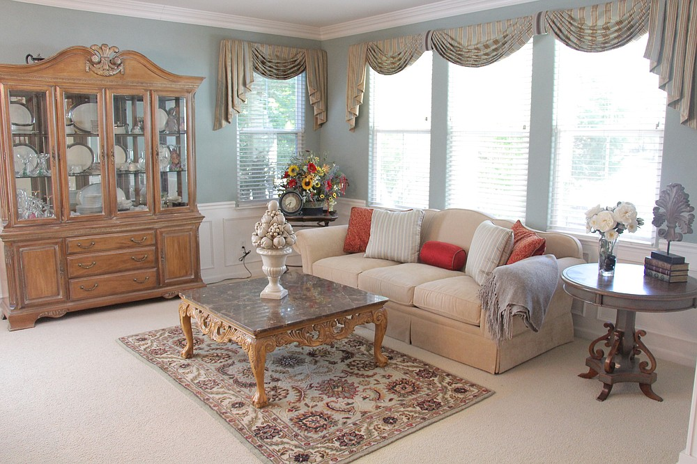 In this living space, valances are used to add color and pattern. (Design Recipes via TNS)