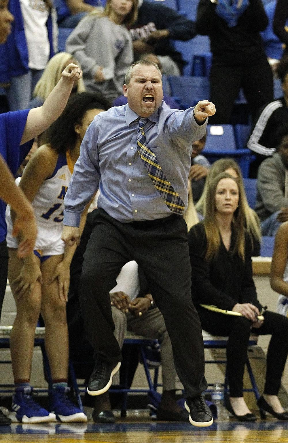 North Little Rock head coach Daryl Fimple yells to his players during the fourth quarter of the Charging Wildcats' 70-64 win on Friday, Feb. 15, 2019, at North Little Rock High School.  (Arkansas Democrat-Gazette/THOMAS METTHE)