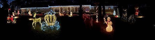 """Merry Christmas from Keith and Kay Smith,"" the couple writes in the submission of the photo of their family home's Christmas display."