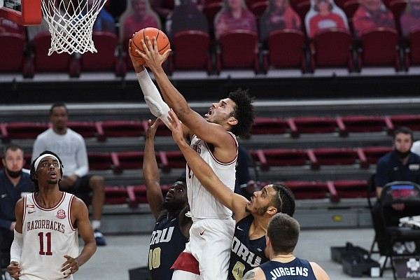 Arkansas forward Justin Smith grabs a rebound during the Razorbacks' 87-76 win over Oral Roberts on Sunday, Dec. 20, 2020 at Bud Walton Arena in Fayetteville.