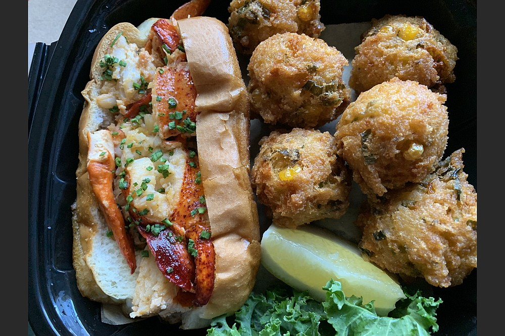There was plenty of lobster in the Warm Buttered Lobster Roll from The Oyster Bar, and we got six hush puppies on the side. (Arkansas Democrat-Gazette/Eric E. Harrison)