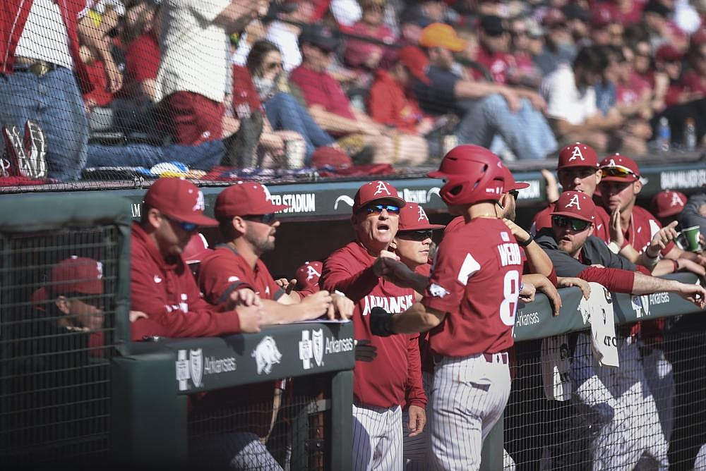 The Arkansas baseball team also had to change  plans. Before long, college and high school sports around the state and the nation were halted by the coronavirus pandemic. The stoppage of sports because of the national health emergency is the Arkansas Democrat-Gazette's No. 1 story of 2020 in state sports. (NWA Democrat-Gazette/Charlie Kaijo)
