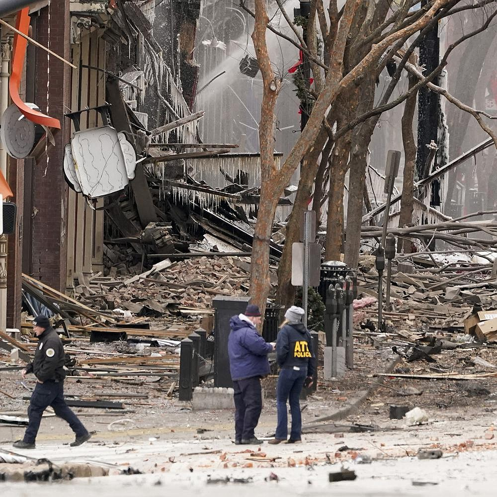 Emergency workers gather near the scene of an explosion Friday morning that sent black smoke and flames billowing over downtown Nashville, Tenn. More photos at arkansasonline.com/1226nashville/.