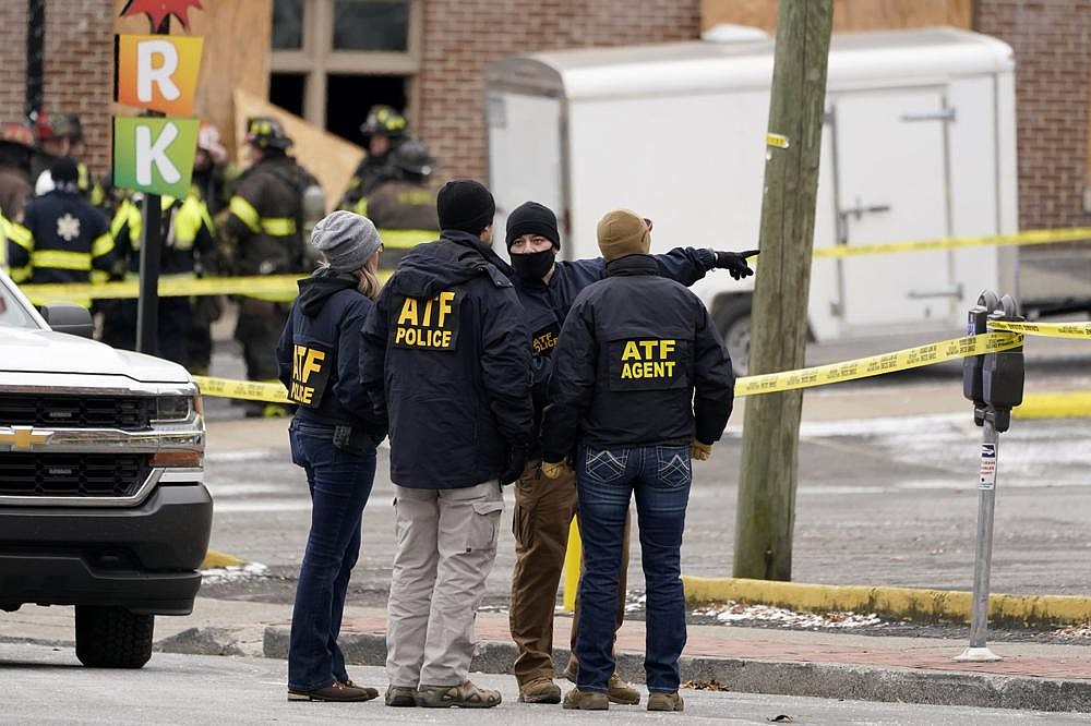 Federal authorities work near the scene of Friday's explosion in downtown Nashville.