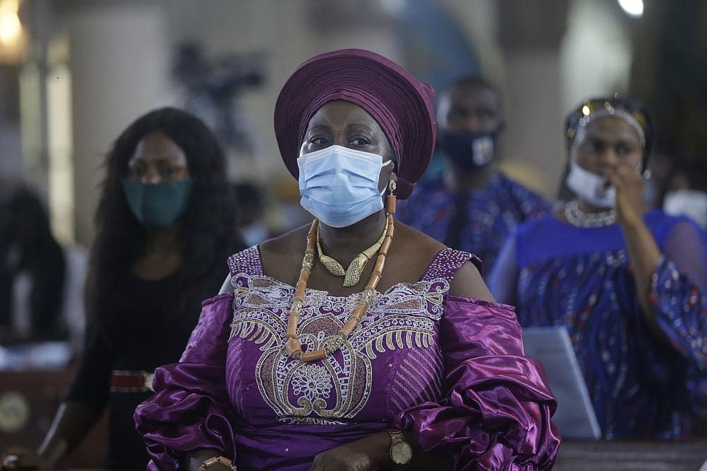 A parishioner wears a mask Friday while attending a morning Christmas Mass at Holy Cross Cathedral in Lagos, Nigeria. (AP/Sunday Alamba)