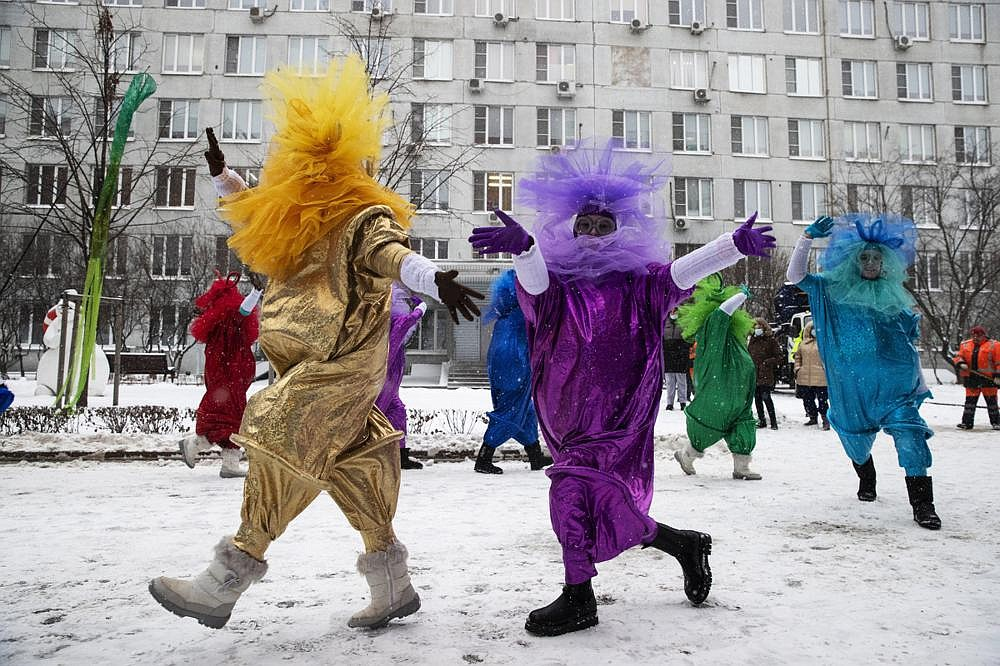 Artists dressed in Christmas costumes perform in the yard of a children's hospital and greet children to mark the coming new year in Moscow. (AP/Pavel Golovkin)