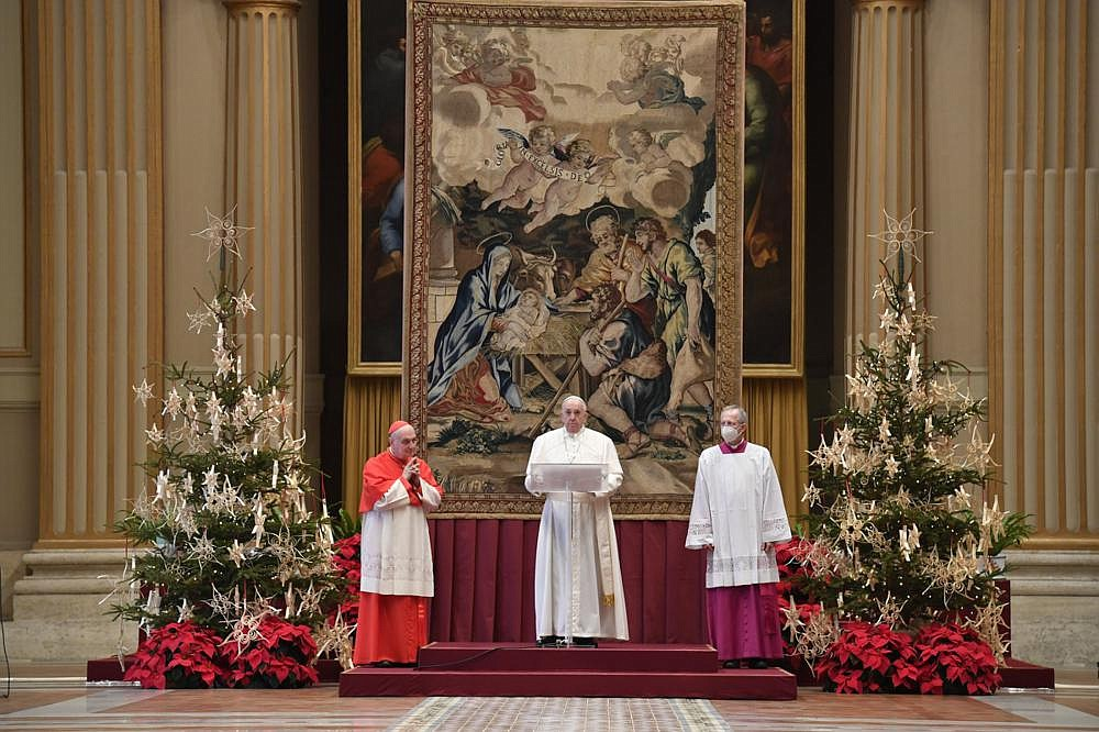 Pope Francis (center) delivers the Urbi et Orbi (Latin for 'to the city and to the world') Christmas Day blessing in the blessing hall of St. Peter's Basilica at the Vatican. More photos at arkansasonline.com/1226noel/ (AP/Vatican Media)