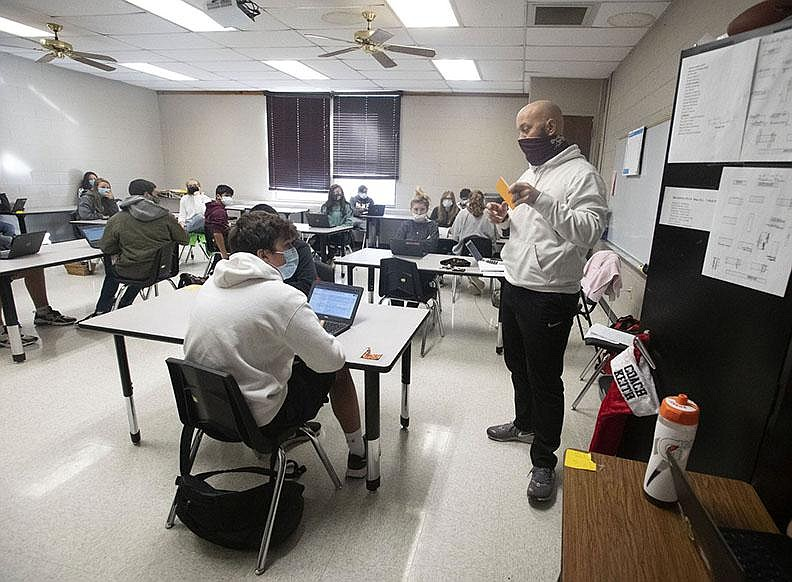 J Keith teaches eighth-grade social studies Dec. 17 at Lincoln Middle School. The rural district in Northwest Arkansas has seen online enrollment decline to about 20% of its 1,000 students.