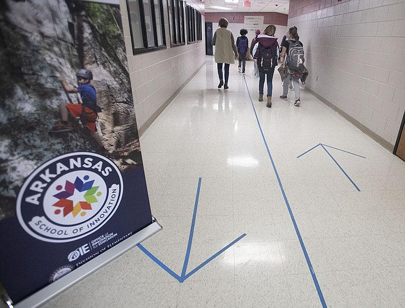 Markers direct student traffic at Lincoln Middle School earlier this month. Superintendent Mary Ann Spears says spotty internet service makes it hard for parents to avoid sending their children to in-person school.
