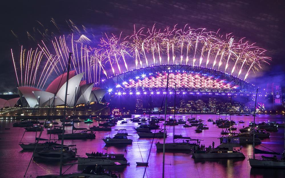 Fireworks explode over the Sydney Opera House and Harbour Bridge in celebration of the new year Thursday in Sydney, Australia. (AP/Mark Baker)