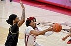 Arkansas guard Desi Sills (3) tries to drive past Missouri defender Mitchell Smith (5)during the second half of an NCAA college basketball game in Fayetteville, Ark. Saturday, Jan. 2, 2021. (AP Photo/Michael Woods)