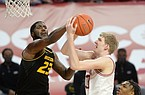 Arkansas forward Connor Vanover (right) has his shot blocked Saturday, Jan. 2, 2021, by Missouri forward Jeremiah Tilmon (left) during the first half of play in Bud Walton Arena. Visit nwaonline.com/210103Daily/ for today's photo gallery.