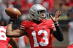 Ohio State quarterback Kenny Guiton looks for a receiver against Florida A&M during an NCAA college football game Saturday, Sept. 21, 2013, in Columbus, Ohio. (AP Photo/Jay LaPrete)