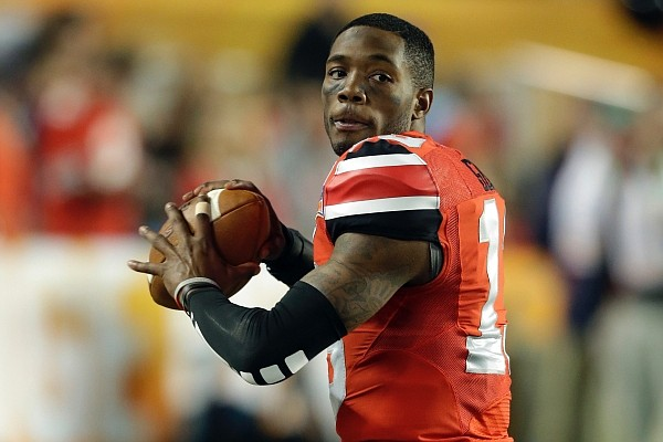 Ohio State quarterback Kenny Guiton warms up on the sideline during the second half of the Orange Bowl NCAA college football game against Clemson, Friday, Jan. 3, 2014, in Miami Gardens, Fla. Clemson defeated Ohio State 40-35. (AP Photo/Wilfredo Lee)