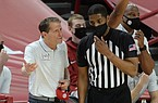 Arkansas coach Eric Musselman (left) pleads Saturday, Jan. 2, 2021, with a game official during the first half of play against Missouri in Bud Walton Arena. Visit nwaonline.com/210103Daily/ for today's photo gallery.