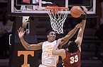 Tennessee guard/forward Yves Pons (35) blocks a shot by Alabama forward James Rojas (33) during a game at Thompson-Boling Arena in Knoxville, Tenn. on Saturday, Jan 2, 2021. (Caitie McMekin/Knoxville News Sentinel via AP, Pool)