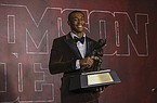 In a photo provided by the Heisman Trophy Trust, Alabama wide receiver DeVonta Smith pose after winning the Heisman Trophy, Tuesday, Jan. 5, 2021, in Tuscaloosa, Ala. Smith became the first wide receiver to win the Heisman in 29 seasons, breaking the monopoly quarterbacks have had on college football's most prestigious award by beating out three of them. (Kent Gidney/Heisman Trophy Trust via AP)