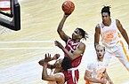 Arkansas guard JD Notae attempts a floater in the lane during a game at Tennessee on Jan. 6, 2021, at Thompson-Boling Arena in Knoxville, Tenn. (Saul Young/Knoxville News Sentinel via AP, Pool)