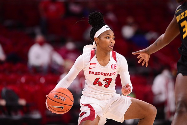 Makayla Daniels dribbles while a Missouri player defends her during Arkansas' 91-88 win over the Tigers in Bud Walton Arena on Sunday, January 3, 2021. Daniels suffered an injury during the game, but has been cleared to play in Arkansas' next game against Tennessee.