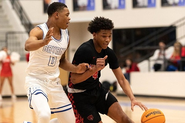 Bryant's Camren Hunter (left) pressures Fort Smith Northside's Noah Gordon as he dribbles down the court during Friday night's game at Bryant.