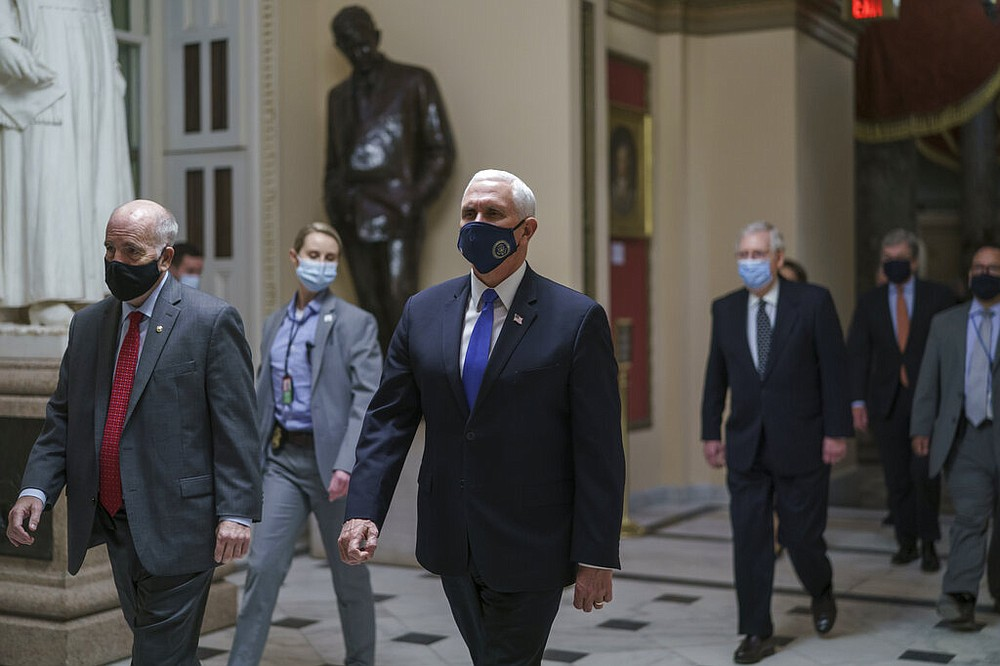 Vice President Mike Pence leads senators to the House chamber at the Capitol in Washington on Wednesday, Jan. 6, 2021.